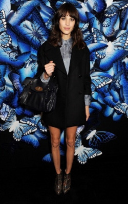 chung-alexa:  Alexa Chung wearing a Miu Miu shirt, leather skirt, Carven boots and her signature navy 'Alexa' Mulberry bag