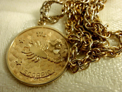 cherchezlaflow:  1970's Sarah Coventry Scorpio Gold Tone Necklace