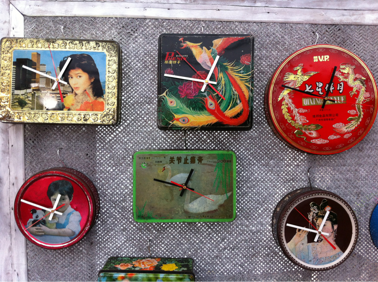 Clocks made from vintage Chinese tins by an artists in Shanghai who also turns suitcases into totally cool iPod docks with speakers. We bought the one top middle. Jake's theory is that if we have more clocks around the apartment I'll be on time…..let's see what happens.  Check www.jonasdesigns.net