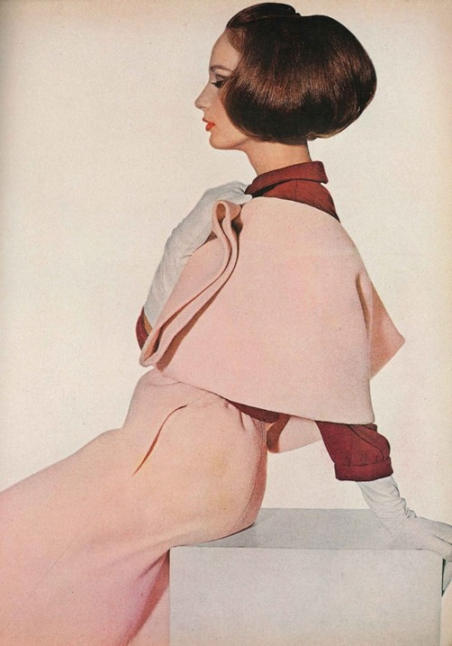 Model wearing a peach cape and skirt for Vogue, March 1964. Photo by Irving Penn.