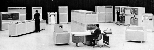 "This image sits right under the heading ""A Typical Computer Center"" in an operators manual for the GE 200 Series computer (1966). I want to be on that team."