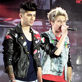 Zayn and Niall being obscenely dumb and cute onstage together