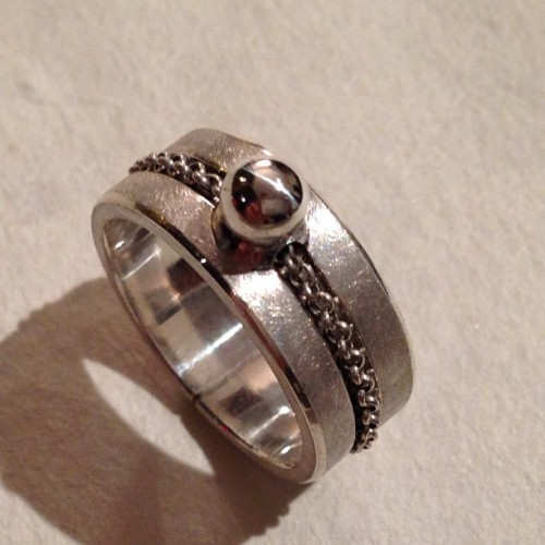 Ball and revolving chain. Custom wedding band. (at Ken Claude Lambert Jewelry)
