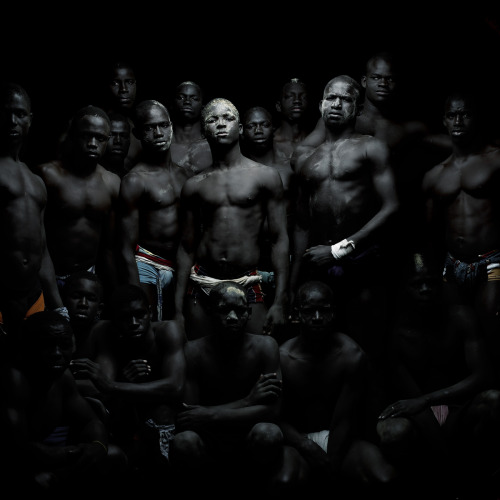 gutsanduppercuts:  An amazing series of portraits of Senegalese wrestlers. This form of wrestling, widely recognized as a martial art, is known as Laamb in Wolof and is Senegal's national sport.