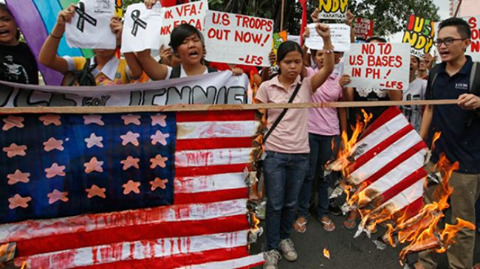 "viletrollfiend:  Activists in the Philippines rallied outside the US embassy in the capital, Manila, and burnt US flag to express their anger over the killing of a woman by a US Marine. On Tuesday, the demonstrators demanded that Washington hand over the Marine who allegedly strangled a 26-year-old woman in a motel room. Jennifer Laude, a 26-year-old trans woman, was last seen entering the Celzone Lodge in Olongapo City with a short-haired male foreigner, aged 25-30, on Saturday night. Later, Laude's body was found in a bathroom at the hotel, apparently strangled and drowned. Philippine police, with the help of a key witness, have identified the Marine as Private First Class Scott Pemberton. He will soon be formally charged with murder. Authorities will file a murder complaint against the Marine on Wednesday, national police spokesman Wilben Mayor said. ""If he remains in US custody, certainly he can escape from our justice system again. We don't want another Daniel Smith,"" activist Corky Hope Maranan said, in reference to another US Marine in the Philippines who was convicted with raping a Filipino woman in 2005. He was able to leave the country in 2009 after a Filipino appeals court overturned Smith's conviction. The protesters also demanded all US troops leave the Philippines. About 3,000 US troops are to leave the Philippines after two weeks of military exercises with Filipino forces. The 11-day annual military exercise dubbed ""Phiblex"" began on September 29."