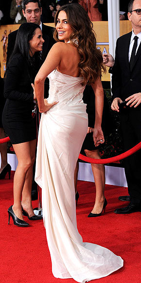 Better From The Back? Sofia Vergara Sofia also chooses to wear white at the SAG Awards, albeit her Donna Karan Atelier lamé gown is just a tad sexier than Kerry's (natch). Check out the front of her dress here.