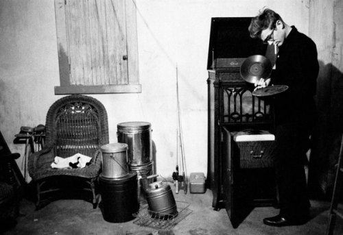 theniftyfifties:  James Dean playing records in his aunt and uncle's basement in Indiana, 1955. Photo by Dennis Stock for Life magazine
