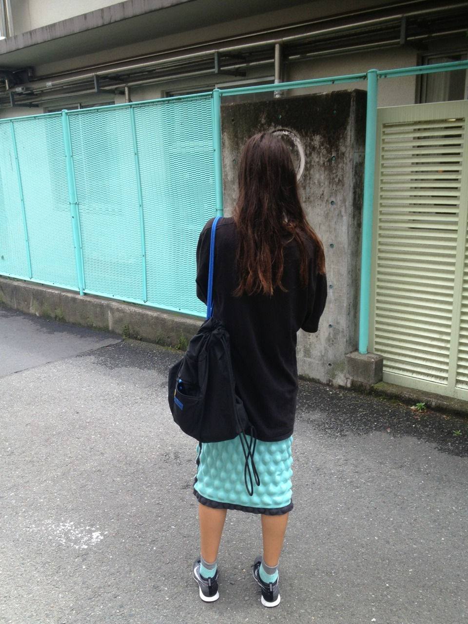 matching dress with wall of kinder next to our apartment in shin okubo