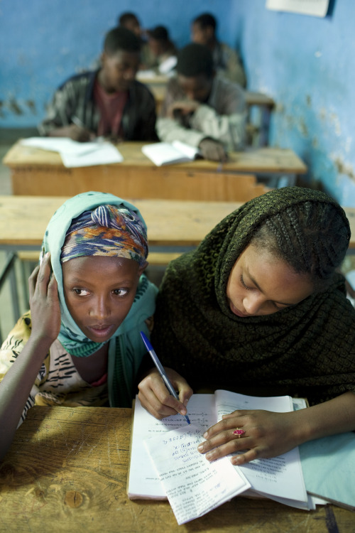 quietbystander:  Two girls at a primary school in the town of Shola Meda study together. Ethiopia, Kewot Woreda, Amhara Region. Photo credit: Panos/Mikkel Ostergaard.