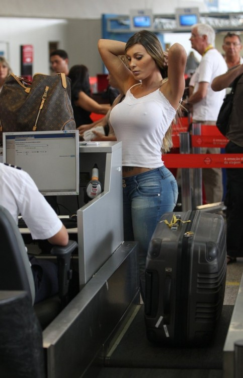 She's clearly trying to smuggle something through customs. Better give her a strip search.