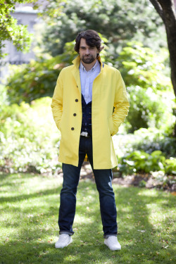 Dane in our yellow trench, premium denim, and oxford. You probably recognize this fella, who's our copywriter, from a few of our photo shoots.
