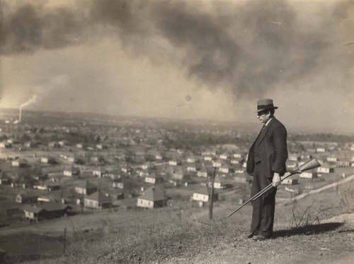 An armed man stands guard above a company town (yikes) in Jefferson County, Alabama, 1937. (ADAH Digital Collections)