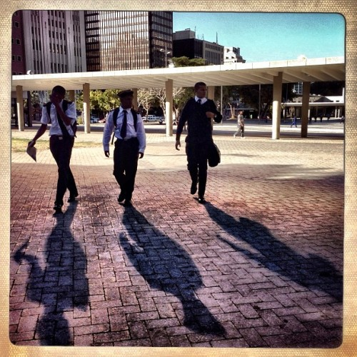 Cape Town, South Africa | February  4, 2013 - A group of students walk to the train station in high winds on Monday afternoon. Photo by   Charlie Shoemaker @charlieshoemaker #capetown #southafrica #students