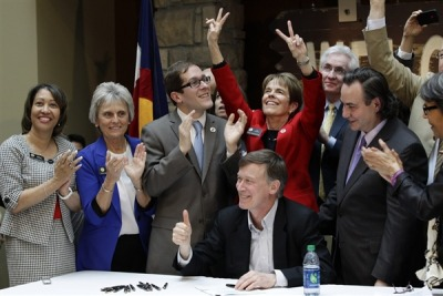 "breakingnews:  Civil unions legalized in Colorado AP: Colorado Gov. John Hickenlooper signed a bill legalizing civil unions for gay couples today. The law takes effect May 1.   ""There is no excuse that people shouldn't have all the same rights,"" Hickenlooper told the crowd during a ceremony at the History Colorado Center near the state Capitol. … Colorado will join eight states that have civil unions or similar laws. Nine states and the District of Columbia allow gay marriage.   Photo: Colorado Gov. John Hickenlooper gives a thumbs up as he celebrates with members of the legislature after he signs the Civil Unions Act into law at the Colorado History Museum in Denver, Colo., on March 21, 2013. (Brennan Linsley / AP)"