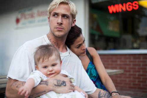 "The Place Beyond the Pines Review.                                                   Spoilers The Place Beyond the Pines is unique. It's not like every film you watch and forget about the next week. The film carries a universal theme. Family. How do we raise our children? What is left for them? How do the actions we make now dictate our future and the future of our children? The Place Beyond the Pines reminded me of Psycho (1960) 30 minutes in Hitchcock kills the protagonist. A physical change in the story that startles the audience into disbelief, a physical change that then changes the storyline completely, our point of view changes but his legacy lives on. Ryan Goslings character Luke dies because he was trying to support his family. I remember vividly a statement he made to Romina (Mendes), ""I wanna be there for the first time he does something, every time he takes a mouthful of ice cream he's gonna see my face"". Ok so why is the film unique? After Ryan Goslings character dies by the hands of Avery (Cooper) (possibly unjustifiably you decide), he is only just introduced. We move on from Luke's storyline of fatherhood to Avery who also has a one year old. Parallel plots, and it feels like it which is what felt so strange in the theatre. Two characters, two protagonists in two plots in a film. But the plot is not whats important, its the theme of family and upbringing that rings out for me. One decision becomes your legacy, one moment defines your life. Avery is a good man and so is Luke, both ends of the spectrum yet so alike. Avery is a father of a top Judge in the state of New York and is morally sound, he attempts to turn in the money Luke earned in the robberies to the police and even tries to return it to Romina, the mother of Luke's baby. in the end the evidence box suffices his guilt.  Avery's decision to run for Deputy Attorney General is an interesting one. He is so dedicated to law that he over see's his son who has gone off the rails. His past, his decisions, they have caught up with him. What we do as people defines us. Avery never forgave himself for killing Luke which I believe is why he strives to become attorney general, he thinks that in him becoming that person, he may overcome that guilt. Only for it to be shoved in his face after Luke's son grows up.  At a certain point in the narrative the film moves time periods to 15 years later which was quite the jump. At this point both children are now teenagers in the same high school. After Jason (Luke's son) finds out AJ (Avery's son') father is his fathers murderer, he buys a gun and forces Avery out into the woods. Avery has nothing but shame and guilt on his shoulders, he cries for his action as he releases what has been tied in him so long.  The one quote that I'll always remember from this film, is moments before Luke gets shot and he knows it, he rings Romina and tells her, ""Just do one thing for me and I'll never bother you again. Don't tell him about me"". The Place Beyond the Pines (2013) 7/10"