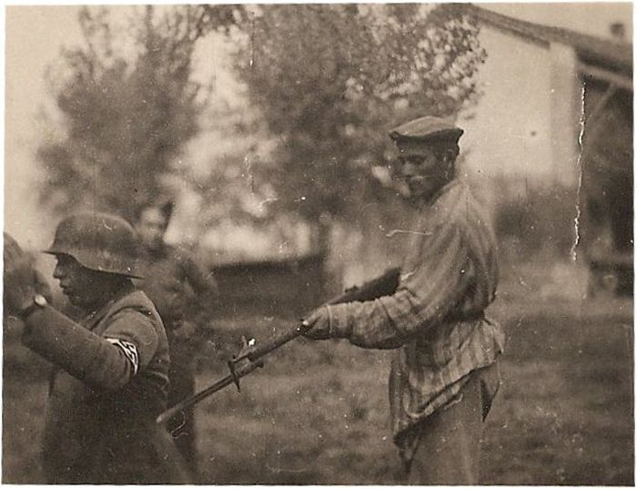 drowningininformation:  A liberated Jew holds a Nazi at gunpoint.