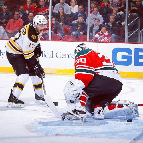 Patrice Bergeron fires his 20th goal of the season past Martin Brodeur during tonight's game in New Jersey. #NHLBruins