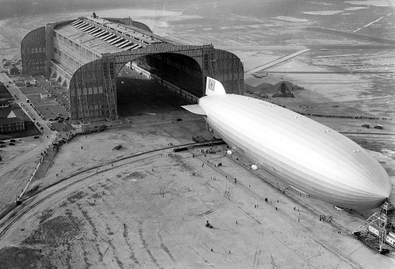 The Hindenburg trundles into the U.S. Navy hangar, its nose hooked to the mobile mooring tower, at Lakehurst, New Jersey, on May 9, 1936. The rigid airship had just set a record for its first north Atlantic crossing, the first leg of ten scheduled round trips between Germany and America. (AP Photo)