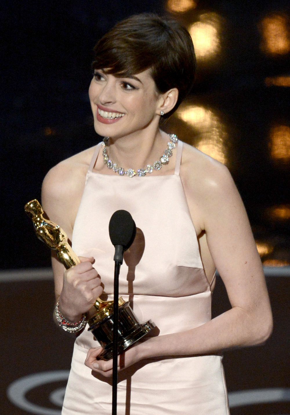 nparts:  Anne Hathaway accepts the Best Supporting Actress award for Les Miserables. (Photo by Kevin Winter/Getty Images) More: http://natpo.st/XzvSrs