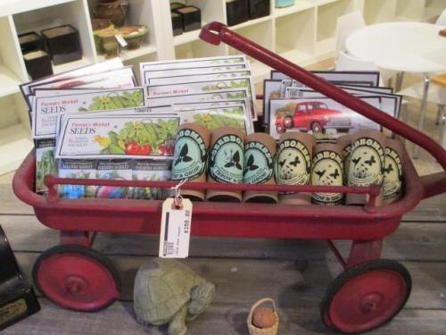 Yay! Greenaid Seedbombs in a little wagon display at Botanica!
