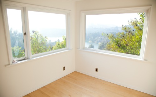The ultimate luxury? An empty room a la Moby… mobylosangelesarchitecture:  caveat, this is sort of a self-involved and potentially obnoxious architecture update, as it involves my house. ok. one of the reasons i moved to l.a was to have more space. having lived in nyc for decades i had become very, very accustomed to living in very small spaces. and i like small spaces. but then l.a beckoned, with it's promise of guest bedrooms and washer/drier rooms and guest bathrooms. space. which, along with light and nature, is the most precious urban commodity (well, i guess friends and family and health could be included). but space. many of my friends in nyc and london have an almost resigned, defeated, and fetishistic approach to space. i've seen new yorkers turn closets into offices (or in my case: a closet into a bedroom. i still sleep in a closet when i'm in nyc. granted, it's a pretty comfy closet). i've seen londoners turn tiny attics into guest bedrooms. and so on. no effort is to small to increase the square footage of a new york or london apartment by even a few feet. and then there's l.a, with it's sprawling gigantic-ness and it's HOUSES. people live in houses here. with guest bedrooms and space. so, when we were renovating my house we got around to renovating one of the guest bedrooms. a beautiful bedroom overlooking hills and a lake. but when the house was done i realized that i already had a couple of guest bedrooms, and no desire to have more guests. so rather than have another guest bedroom i decided to have the strangest of urban luxuries: an empty room that has absolutely no purpose. i know, it seems like an absurd indulgence. and i guess it is. but i have a room with no purpose. just a beautiful empty room. sometimes it gets used for yoga, sometimes people use it for meditating, sometimes people use it for sleeping. but most of the time it just sits quietly on it's own, calm and empty, almost like my own james turrell room. i hope i haven't offended you with my empty room, or with these pictures of an empty room. i can see how new yorkers in particular would have a particular antipathy towards an empty room. which might be one reason why more and more of my new yorker friends are moving to l.a. thanks, moby