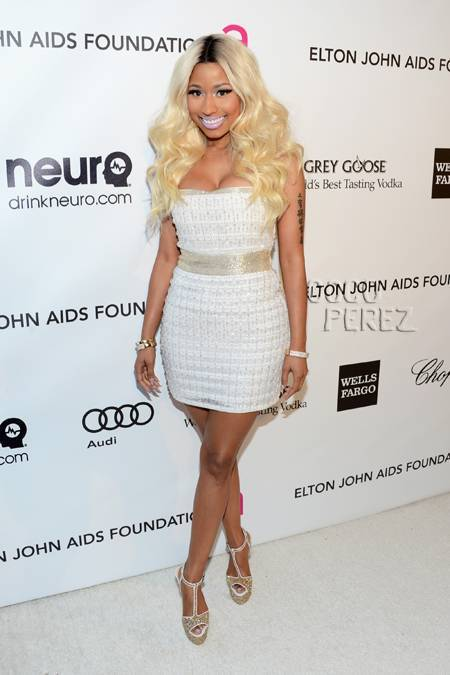 ON AN UNRELATED OSCAR NOTE….THIS LOOK NICKI GAVE MADE ME SMILE. WHILE ATTENDING ELTON JOHN'S AIDS FOUNDATION GALA, NICKI LOOKED VERY PRETTY AND TONED DOWN. BEAUTIFUL COCKTAIL DRESS, GOLDEN LOCKS, AND ROCKING HER NEW VIVA GLAM LAVENDER LIP! WAY TO GO NICKI!!