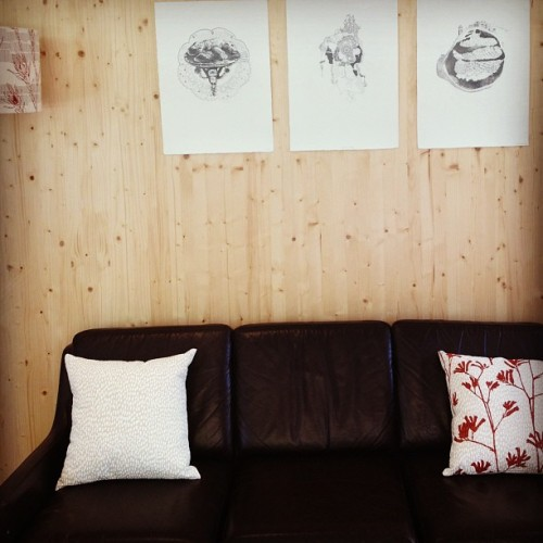 A series of three of my graphite drawings chilling above the comfy looking couch in the Forte #inkandspindle apartment! #slfaus #melbourne