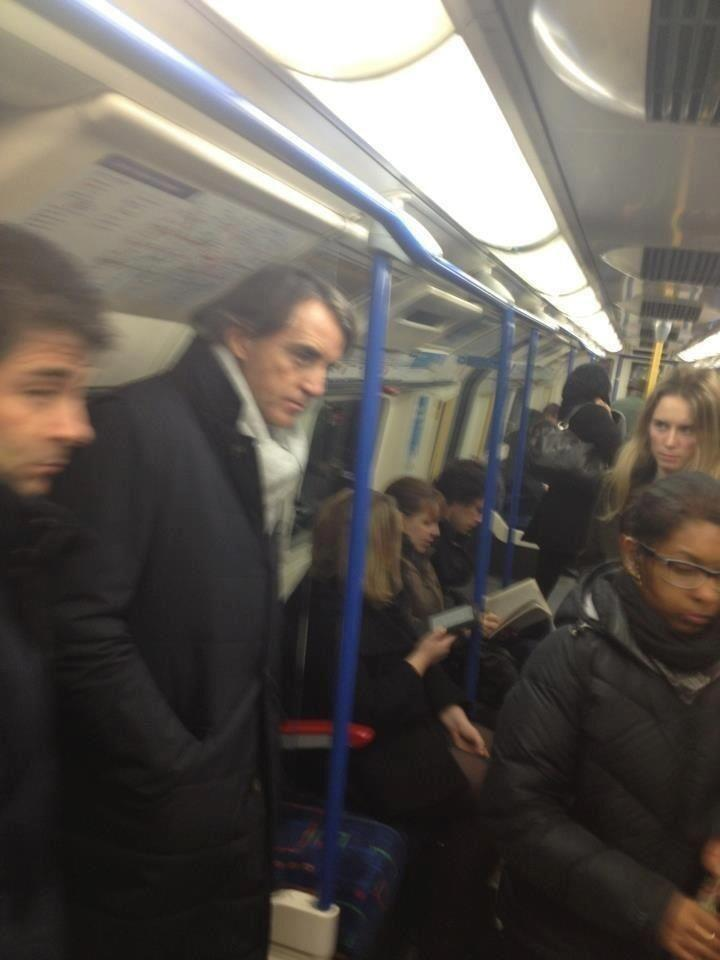 The look of doom. Mancini takes London Tube home after FA Cup Final loss Update: Photo is from earlier this season.  But still… a slice of poetry via @Ankaman616