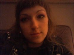 Hiie crappy grainy photo time capsuled selfie. Last night's installment of…ME. went to a friends cancer benefit. Donated $20. Wolfed down a burger and fries. Drank one shock top beer and bought a beer and fries for Aldur. Yes yes broke my sobriety but I didn't get drunk and also fuck it. I lm still not smoking weed which is what has been making me apathetic, lazy, antisocial, timid and blah. Love pot but fuck I need a break to take back my existence or die like a punk. I know I may dress like a punk sshhh. Anyway. I don't feel bad for drinking. I gave my brain tumours/cancer friend/ex-lover a badger face (real), a shell, shark teeth aand some good hugs. Be well!