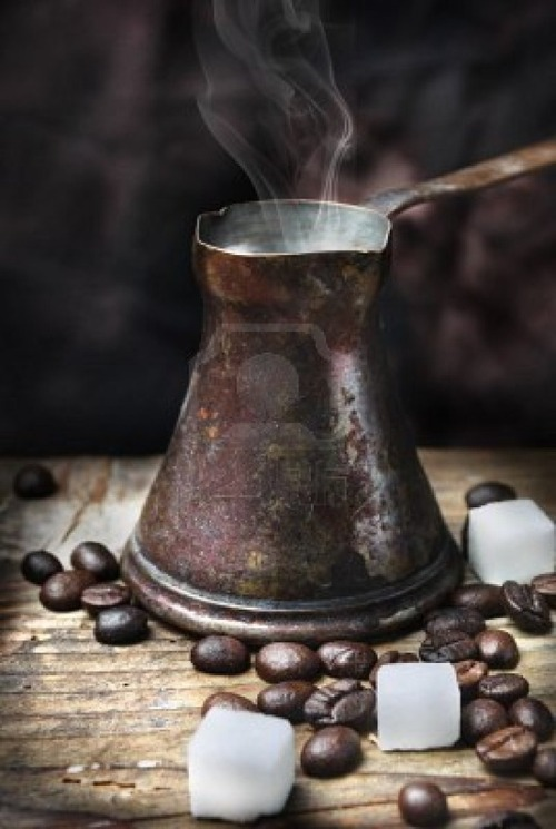 weeheartfood:  Old-fashioned oriental coffee pot on grunge wooden plank