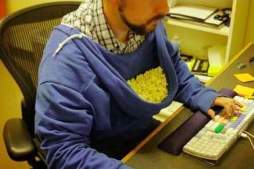 Hoodie as Popcorn Holder is Ultimate Lifehack It's a feeding trough. For people. Lazy, innovative people.