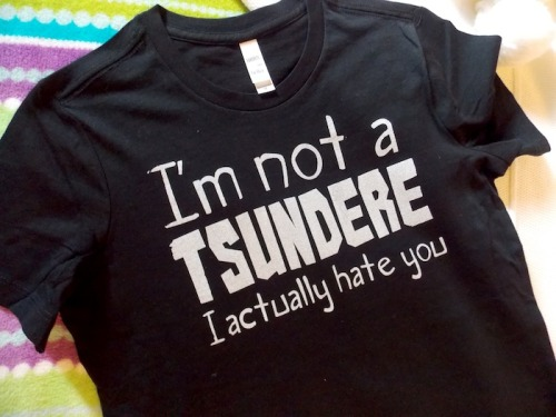 (^~^) eheh.Get this and more offensively awesome designs here at Gesshoku!http://www.gesshoku.com/advanced_search_result.php?keywords=not+a+tsundere