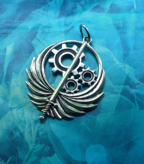 falloutuniverse:  fyeahfallout:  Brotherhood Of Steel Pendant by Silver-Otter  I WANT THIS SO BADLY!