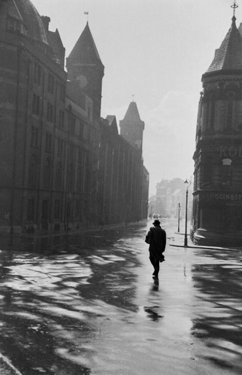m3zzaluna:  wet newcastle a solitary tyneside man walks the wet streets of newcastle, england, 1954. photo by maurice ambler.