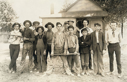 pitchersandpoets:  collectivehistory:  Baseball team composed mostly of child laborers from a glassmaking factor,  Indiana, August 1908, by Lewis Hine (LOC)   tough hats jr edition