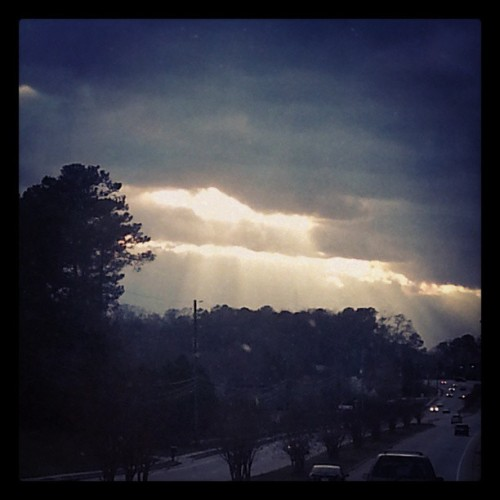 The sun beaming through the clouds over Stone Mountain.  God is <3