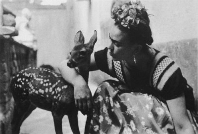 weareallprostitutesandjunkies:  Frida Kahlo and her pet deer, Granizo, 1939, photograph by Nickolas Muray