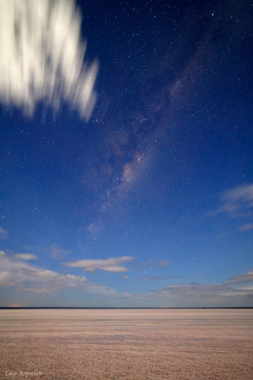 "Milky Way Below Sea Level ""The photo shows the Milky Way just after twilight from the salt flats of El Gualicho in Patagonia, Argentina. Altitude is 72 meters below sea level. The Milky Way was visible to the naked eye even when the the sky was not totally dark yet. There're hundreds of stars reflected on the salt too."" — Luis Argerich"