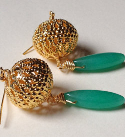 """Gold plated baubles with intricate woven pattern with drop persian green oval agate stone. Inspired by the childhood classic ""Tikki Tikki Tembo"". Just like the mother thinks of the first son, you will agree these earrings are ""the most wonderful thing in the whole wide world!""From afar, these earrings are gorgeous. They have great color and beautiful movement. The bauble gives just enough weight to the teardrop. But up close you see how intricate the design on the bauble is. A bit of wire-wrapping connects the two halves but also adds a bit of gold that sets off the persian green. We also like the contrast of the round bauble and the pointy teardrop.The earring measures 2 1/2"" from earwire to bottom of the teardrop. The diameter of the wire circle is just over 1/2""."" - Wellsmarie The ladies at Wellsmarie are offering 5-15% off their merchandise when you enter the code FASHIONTRIBE at checkout."