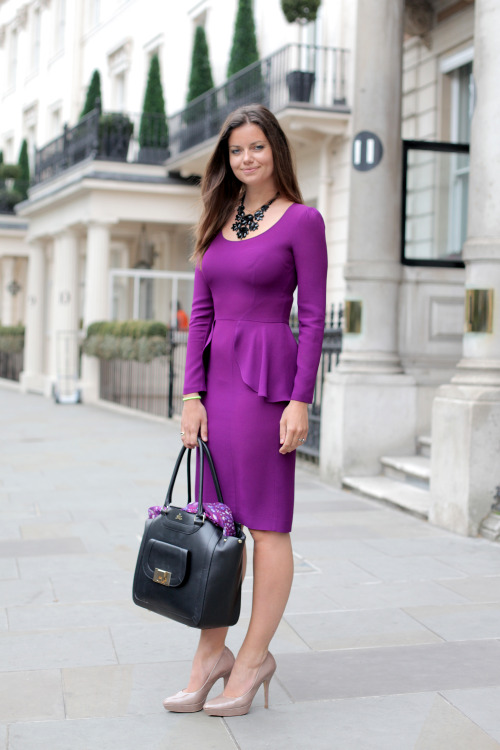 Office Opulence  Today Nats is wearing Beulah's Ildi Dress in purple. For a classically chic look for the office she has accessorized this fabulous dress with nude heels, a black statement necklace, and Milli Millu's multi-tasking Zurich Bag. Never without one of our signature scarves nearby, Beulah's purple Painted Lady shawl is stored in her bag. You don't have to sacrifice your personal aesthetic for a business day as workwear is no longer limited to monochromatic separates. The crisp tailoring of the dress makes it appropriate for a busy day at work while the eye-popping purple palette and ruffled detailing ensures a flatteringly feminine look. The Ildi proves its versatility when one considers that whilst this look is ideal for a day of running from meeting to meeting, it will also look fabulous later on in the evening when gossiping with friends over after work drinks xx