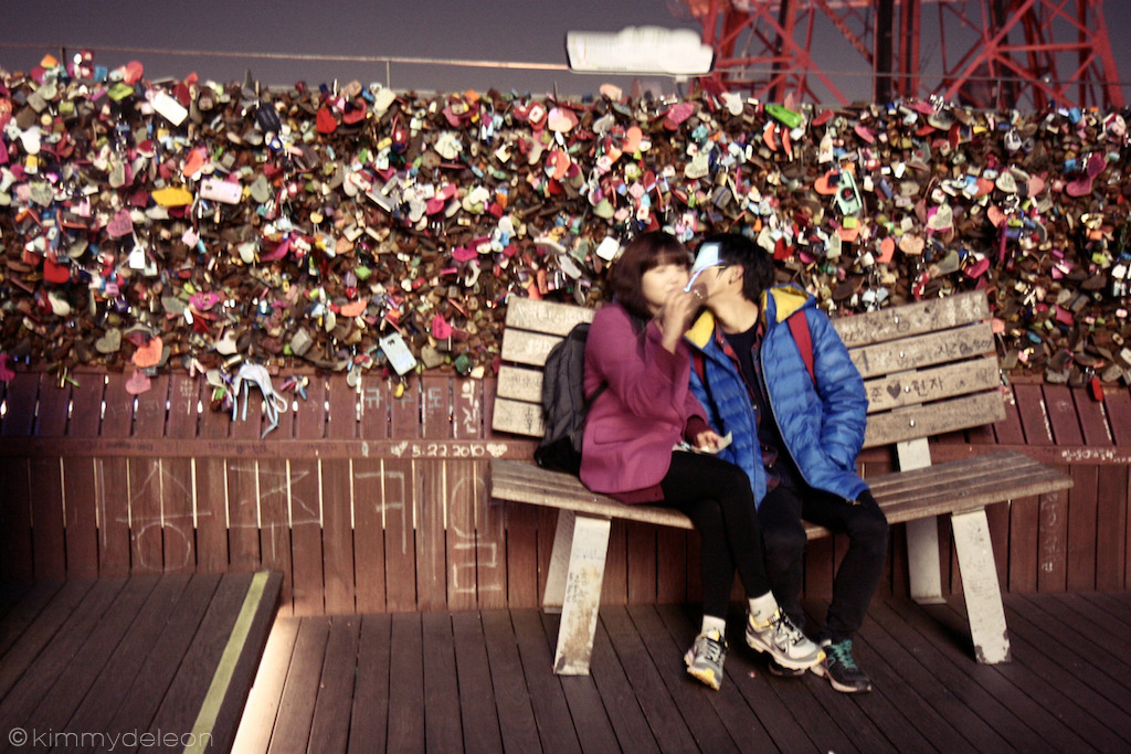 Locks of Love | N Seoul Tower, Seoul, South Korea A sweet stolen moment of a couple kissing in the Locks of Love garden in N Seoul Tower.