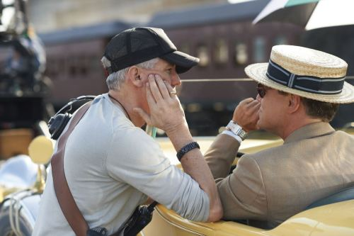 "gatsbymovie:  Great read! Director Baz Luhrmann explains why he chose to incorporate 3D, hip-hop and the sanitarium into The Great Gatsby: http://huff.to/13tOije  ^THIS^ Not that he needs to defend himself — he's the director and he's at liberty to interpret and present the story as he sees fit. Many of the people criticizing the movie either haven't seen any of his other work (do yourself a favor: watch Romeo + Juliet now), or they're judging this one before having seen it. I understand some of the criticisms about the music, yet I loved it. I'm a Jay-Z fan, but I could've done without so much of his music (there are 2 songs of his on the soundtrack and a couple of others briefly sprinkled into the movie, not to mention a Beyoncé cover AND her covering Amy Winehouse. Like, we get it). Everything else, though? Lana, Florence, the xx, Gotye… Ah-maze. I don't know that we needed to hear every song in the movie, but it was an interesting juxtaposition. The words of the original story are timeless, yes, but this version presented the story in a different light. Why would you want to see the same interpretation over and over? It's a beautiful movie and Leo kills it, as per usual (even GQ agrees). Breathtaking. Lots of style and glitz and glam — it's over the top, in the best way possible, and still has the same heart and inevitable tragedy as the book I fell in love with, too. It's a unique take on a story that's been ""reimagined"" many times. Flawless? No. But entertaining nonetheless. Give it a shot."