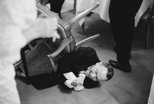 marlondeans:  Frank Sinatra falls off a chair while laughing at a joke, 1965.
