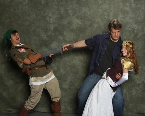 gamefreaksnz:  Link getting stabbed by Nathan Fillion, while Zelda swoons in his arms