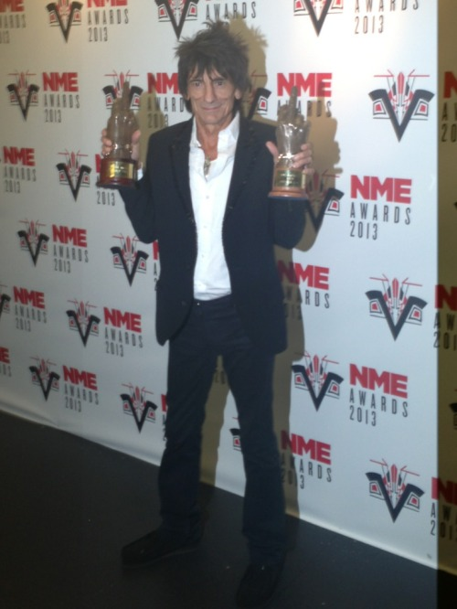 "rollingstonesofficial:  Double victory for the Rolling Stones at tonight's NME Awards!  Tonight the Rolling Stones celebrated a double victory at the annual NME Awards held at London's Troxy. They were awarded Best Live Band and Best Music Film for Crossfire Hurricane. Ronnie Wood was in attendance to pick up the two awards and he played on stage with winner of the Godlike Genius Award, Johnny Marr. Over 10 million votes were cast by NME readers to vote for the awards. Ronnie said ""It's only taken 50 years! The boys are going to be really pleased when they hear about this!"""