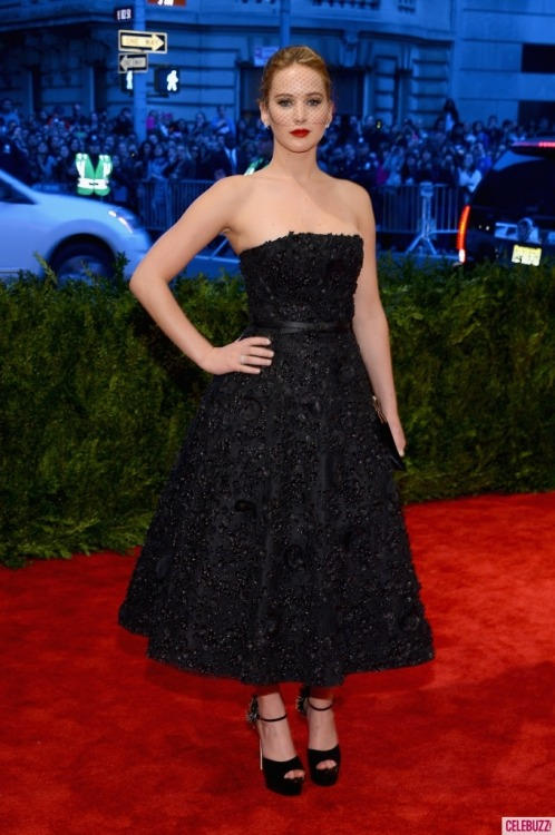 Jennifer Lawrence looked like a vintage dream in Christian Dior on the Met Gala red carpet.  The strapless, jewel-encrusted Dior gown is classically glamorous, and the black birdcage veil takes its elegance to another level.  Jennifer's flawless porcelain skin, deep red lip and black-lined eyes are the perfect classic makeup for this timeless look.