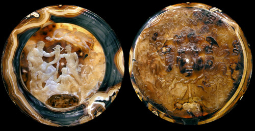 "isgandar:  The Farnese Cup (Tazza Farnese) is a 2nd century BC cameo cup of Hellenistic Egypt in four-layered sardonyx agate. It is 20 cm wide. After Octavian's conquest of Egypt in 31 BC, the Farnese Cup was acquired by the Treasury of Rome. It was later brought to Byzantium, then back west after this city was sacked in 1204 during the Fourth Crusade. By 1239 it was in the court of Frederick II, from which it then reached the Persian court of Herat or possibly Samarkand, where a contemporary drawing documents it; thence it found its way to the court of Alfonso of Aragon in Naples, where Angelo Poliziano saw it in 1458. Lorenzo the Magnificent finally purchased the famous ""scutella di calcedonio"" in Rome, in 1471. From there it came into the possession of the Farnese family through Margaret of Austria and thus into the Naples National Archaeological Museum.  ""The bottom of the interior of the cup is decorated with a Sphinx upon which sits a female figure with ears of wheat in her hand; to her left, on a tree, there is an imposing male bearded figure with a cornucopia; at the centre a young man stands and leans on the shaft of a plough and holds a sack full of seeds in his arm. To the right are two seated female figures, one of whom holds a phiale, while above there are two male figures transported by a cloak blown by the wind. On the bottom of the external surface is a large gorgoneion, which reflects the tragic and grandiose tone of baroque Hellenism; the Gorgon's nose has a small hole in it, already noted in the Farnese inventory of the sixteenth century, and has been interpreted as the trace of a support for display purposes. The presence of the Sphinx provides a direct reference to Egypt, and marks the point of departure for all the interpretations of the iconography proposed up till now. According to the traditional interpretation, the scene alludes to the flooding of the Nile, Eutheneia, which can be identified as the female figure in Isiac vestments, to the fertilising power of the river, symbolised by the imposing bearded figure on the left, and to the beneficial effects for Egypt, represented by the Sphinx. Subtler attempts at explanation have also been put forward over time aimed at identifying the seven characters as the main deities of the Egyptian pantheon, even though in a moment of religious syncretism in which traditional cults were assimilated with the Eleusine mysteries, or at interpreting them as historical figures linked to a specific event, of which the cup preserves the memory. According to the first interpretation, the Sphinx represents the symbol of the Ptolomeic kingdom dominated by Isis, who can be identified by her hairstyle and clothing; on her left stands her brother-husband Osiris and the centre Horus-Harpokrates; the two female figures on the right, behind whom can be seen crops, are the Horai, the deities of the seasons and the harvest, or the personification of cultivated land and dew; the two gliding figures above are the Etesian winds which blow from the North. The reference to historical characters and events, undoubtedly a fascinating suggestion, cannot go beyond the identification of the three central figures with the three figures of the family of the Ptolemies (the female figure can be probably be identified as Cleopatra I, as is demonstrated by the comparison with her portrait in the Louvre). The association between the serene depiction on the obverse and the terrifying image of the Medusa on the reverse has been interpreted as a reference to the royal family, which knew how to govern peacefully but would adopt an inflexible approach when necessary.  Some help with the chronology of the object is provided by comparison with glass objects painted in gold of Alexandrine production which indicate the presence, between the third and the second century, of a plate with an everted rim morphologically very similar to the cup. Other fundamental indicators are stylistic analysis, which associates the cup with forms of early Hellenistic date, and the type of inlay, which is extremely complex comprising least four layers, with relief engraving on both faces. As regards its function, it seems certain that it was not used for banqueting: it is more plausible that it would have been used for ritual libations."" - Museo Archeologico Nazionale di Napoli"