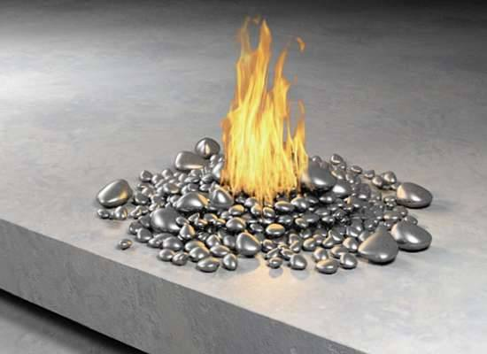 designed-for-life:  Ultra Modern Fireplaces by  Elena Colombo  Spending more time and money on our outdoor spaces has been a growing trend for a while now, and fire pits and fireplaces are a huge part of outdoor decor. These fire sculptures are dramatic examples of the future of outdoor accessories. They are made of steel, bronze and stainless steel, and are equipped to burn either propane or natural gas, so they burn cleaner and are more convenient and safer than wood. The Colombo Construction Corporation is owned by architectural designer Elena Colombo of New York, whose collection also includes wind and water features.    Via: http://www.trendhunter.com/trends/luxury-fire-features-ultra-modern-fireplaces-by-elena-colombo