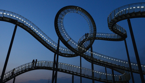 "The landmark ""Tiger & Turtle"" sculpture that resembles a roller coaster is pictured at the former zinc smeltery's grounds Krupp Mannesmann in the Angerpark in Duisburg-Wanheim on Jan. 13. One hundred twenty tons of galvanized steel are mounted and welded for the sculpture on the heap. The walkway area will amount to 220 meters including 249 steps. (Patrik Stollarz/AFP/Getty Images) (via Daily Life: January 2013 - The Big Picture - Boston.com)"