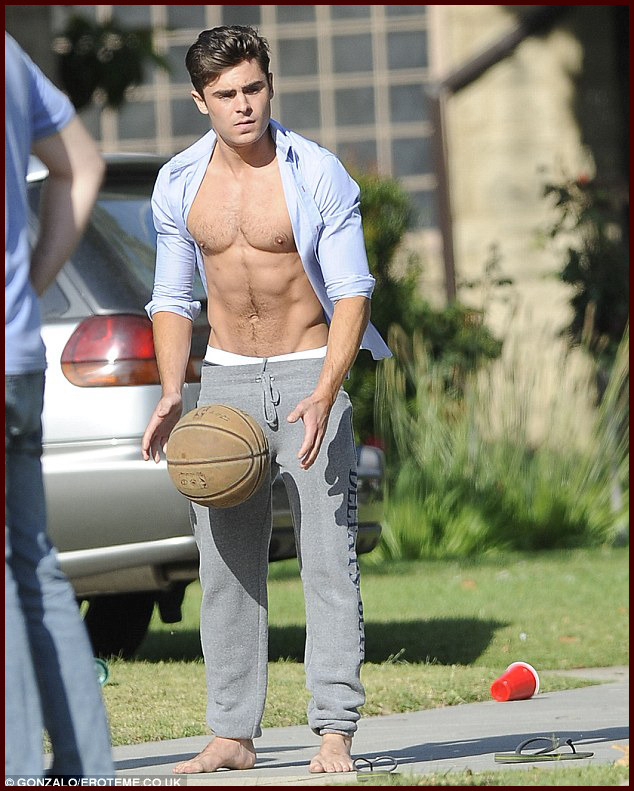 shineonmedia:  Holy mother of Zefron! Zac Efron spotted semi shirtless (AGAIN) on the set of 'Townies'! More pics here!
